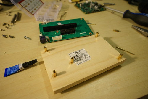 SuperGlue and the board with mounted standoffs